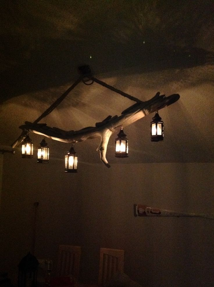 Driftwood chandelier with lanterns, courtesy of Matt. Lights are on a dimmer switch.