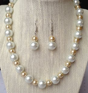 Champagne pearl bridal necklace and earring set. This lovely set is designed with chunky bright white glass pearls and champagne glass pearls. Necklace closes with a silver lobster clasp and a 2 inch extender chain that allows flexibility for length of necklace. Perfect gift for Bridesmaids!  MATERIALS: ~ Glass Pearls measure 8mm to 12mm ~ High quality nylon coated 49 strand bead wire is used to ensure durability and long lasting wear. ~ Silver lobster clasp w/ 2 inch extender chain ~ H...