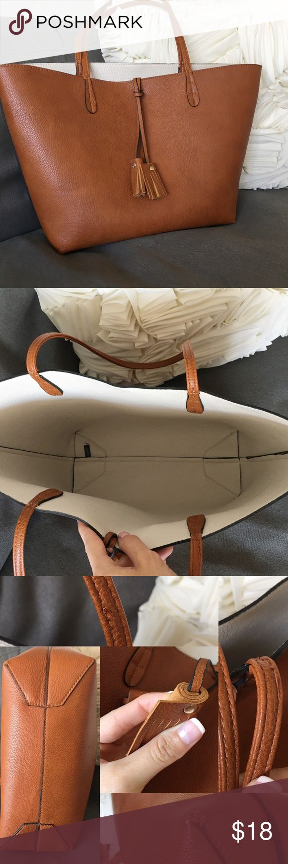 """Stitch Fix Parvin Reversible Tote w Tassels Super cute tote with tassels on the outside.  It fits more than you think--books, laptops up to 15"""", makeup bag, water bottle, umbrella... great for college/university & perfect for the girl boss on the go!  Dimensions: 11"""" height x 11"""" wide (base) x 18.5"""" wide (top) x 5"""" depth x 10"""" strap drop 