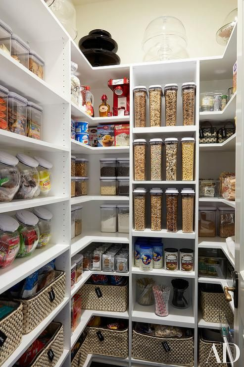 Khloe Kardashian - Super organized kitchen pantry boasts white modular shelves filled with plastic bins and woven baskets.