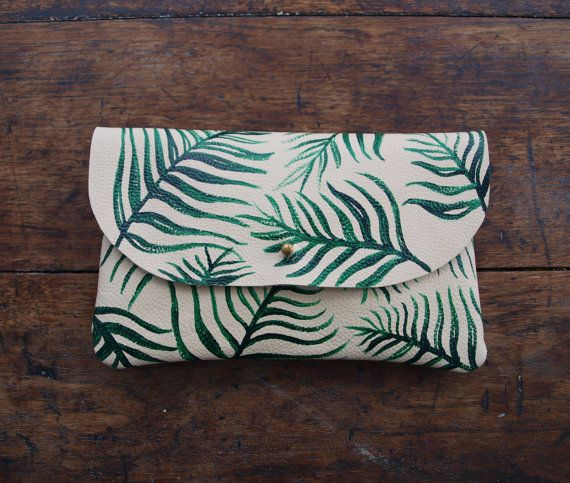 Love the hand-painted fern motif on this clutch. For the naturalist at heart, a cream-colored clutch hand-painted with a vibrant fern pattern.