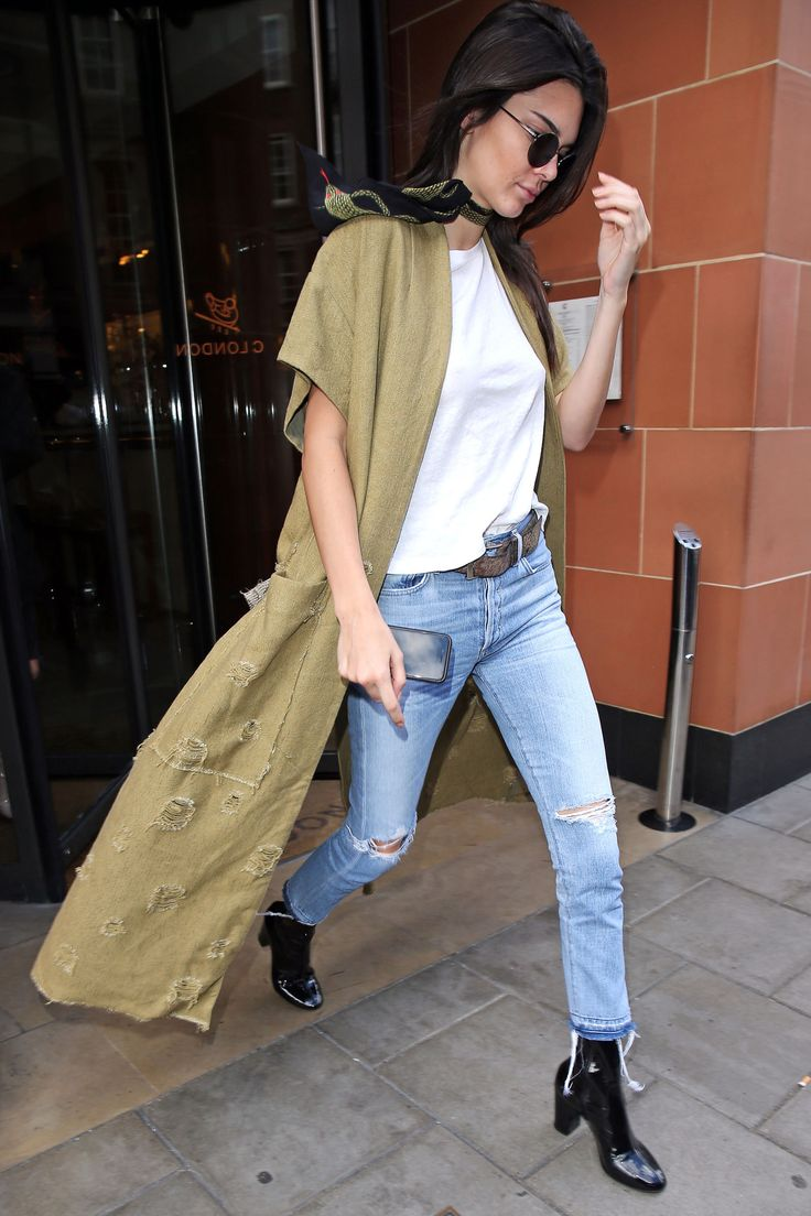 May 23, 2016 - street style, Kendall Jenner in ripped jeans, white shirt, khaki trench and black patent boots