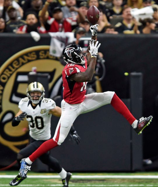 Atlanta Falcons wide receiver Mohamed Sanu (12) leaps for a pass against New Orleans Saints defensive back Erik Harris (30) in the first half of an NFL football game in New Orleans, Monday, Sept. 26, 2016.