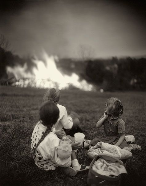 Often we try and capture the faces, but here's a beautiful reaction shot by Sally Mann