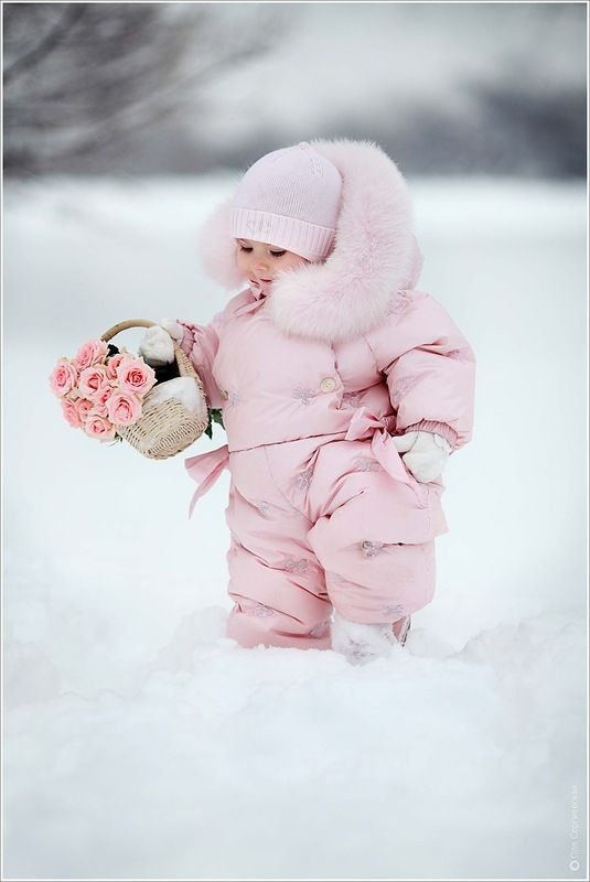 What an adorable, sweet little girl. Pink Snow bunny with a basket of pink roses.  http://500px.com/photo/3889965