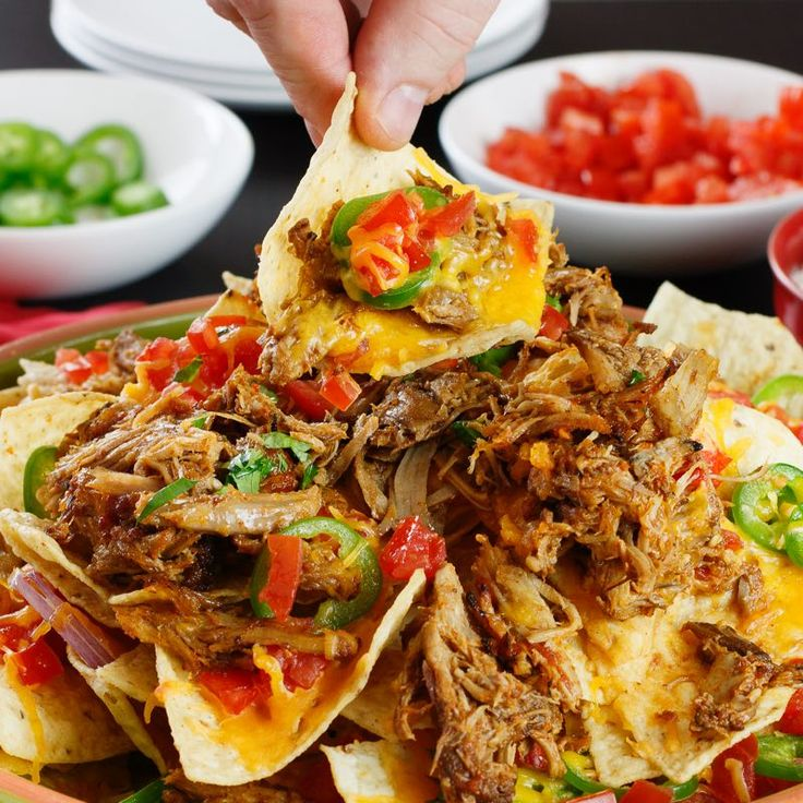 Game day glory starts with this recipe for baked Pulled Pork Nachos. One pan. Pulled pork. And oh-so-many toppings. (Think diced tomatoes, kickinandrsquo; jalapeños, cool sour cream and more.)
