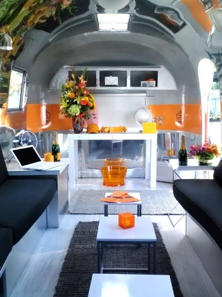 "1961 Airstream Globetrotter 20' ""Luxe Lounge"" interior by Kristiana Spaulding. he Luxe Lounge is a rental Airstream designed to be used as a multifunctional space from a design studio to a mobile lounge."