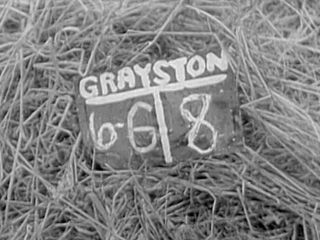 Sergeant Alan Grayston's slate taken on D-Day at Courseulles-sur-Mer. A week later he never uses it again, possibly lost in the artillery strike that killed his assistant, Private Lew Currie.