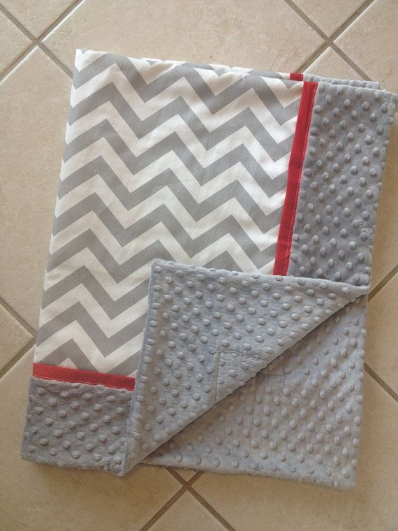 Baby blanket grey chevron with red trim and by Briteshasblankets, $54.99 Maybe a changing pad cover in grey chevron and grey minkey with teal or green trim?