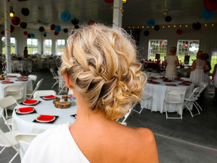 A bridesmaid hairstyle for an outdoor rustic wedding.