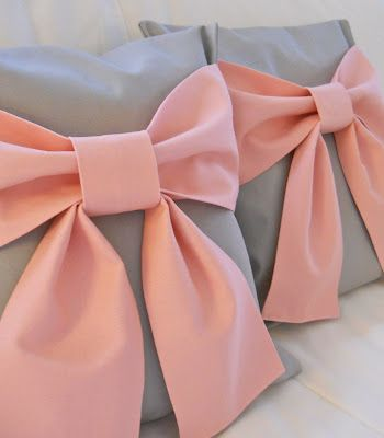 I want to make these!!!! but with lavender bows and a darker gray.  Bow throw pillows