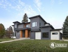 Modern home Exterior, 2-storey, wood accents, infill corner lot. Custom Infill in Crestwood, Edmonton by Kimberley Homes.  #interiordesign #newhomedesign #homedesign #newhome #customhome #yegre #buildwithkimberley #kimberleyhomes #moderndesign #exteriordesign #yeginfill