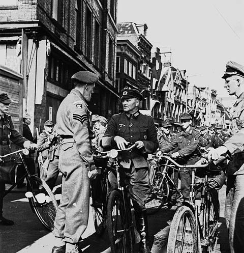German officers and men surrender to Canadian troops in Utrecht, 8 May 1945.