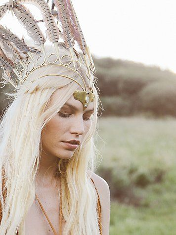 Fire Of Fires Crown | Made in the United Kingdom, this tribal-inspiredheadpiece is made from solid brass wire with statement feather detailing.  Front pendant has beautiful moon stone.  Adjustable strap in back.