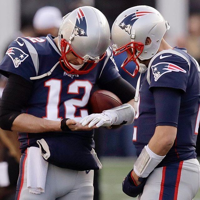 Patriots Quarterback Tombrady Looks At His Taped Right Hand Beside Backup Quarterback Brianhoyer Before Th Patriots Team Afc Championship Patriots