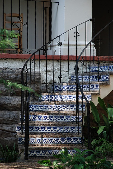 Graceful Exterior Curved Staircase With Spanish Tile Risers Iron Railing Staircase Stairs