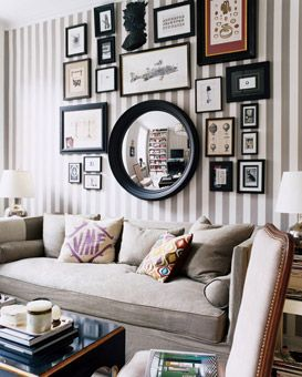one of my all-time favorite living rooms: stripes, collage, fish, gold = perfect
