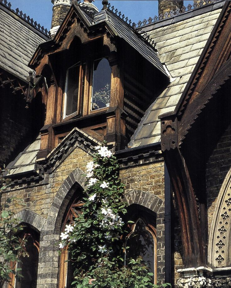The stunning facade of a rustic gothic revival home for Gothic revival home