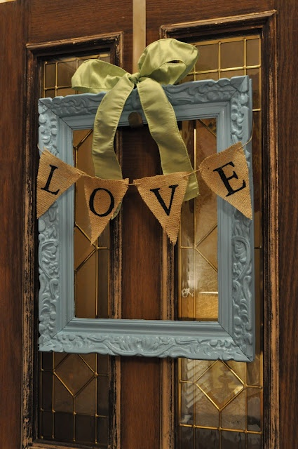Using a frame in place of a wreath on the front door!