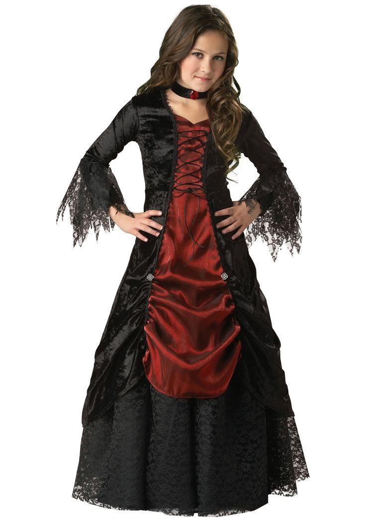 Girls Gothic Vampira dress 100% polyester Red taffeta inset panel & skirt overlay at center Bodice portion has black cord lacing through loops Self-fabric ties at waist Three-quarter length sleeves have gathered lace cuffs Petticoat w/ elastic waistband Choker w/ faux jewel center Velcros in back