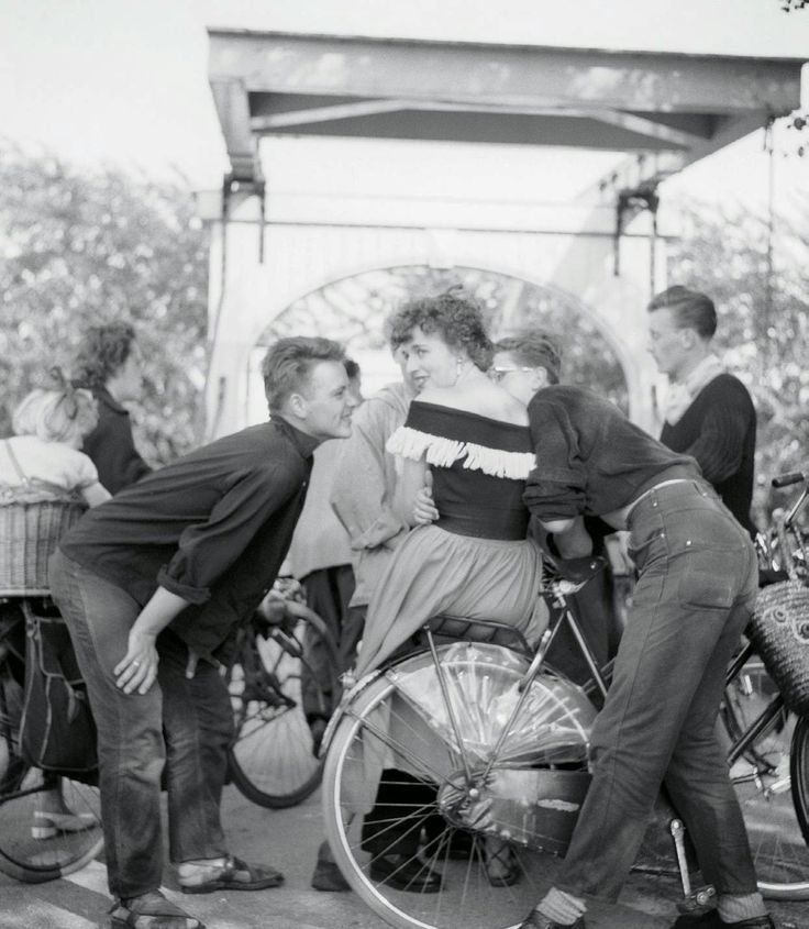 """1962. Youth culture in Amsterdam in the early 1960's. """"Pleiners"""" and """"art student"""" types. The guys wear black turtlenecks, the girl a black sweater with artistic garnish. The bike or small motor bike was their most widely used means of transport. Photo Ed van der Elsken #amsterdam #1962"""