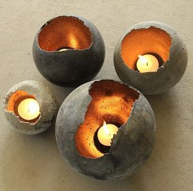 Cement ball-shaped candleholder. Looks like they added gold paint inside too. Leuk! Cement over balloon...