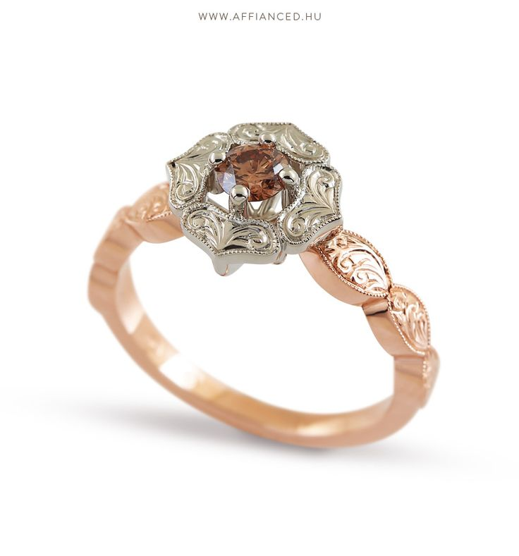 Handcrafted engagement ring with handmade engraving and brilliants.