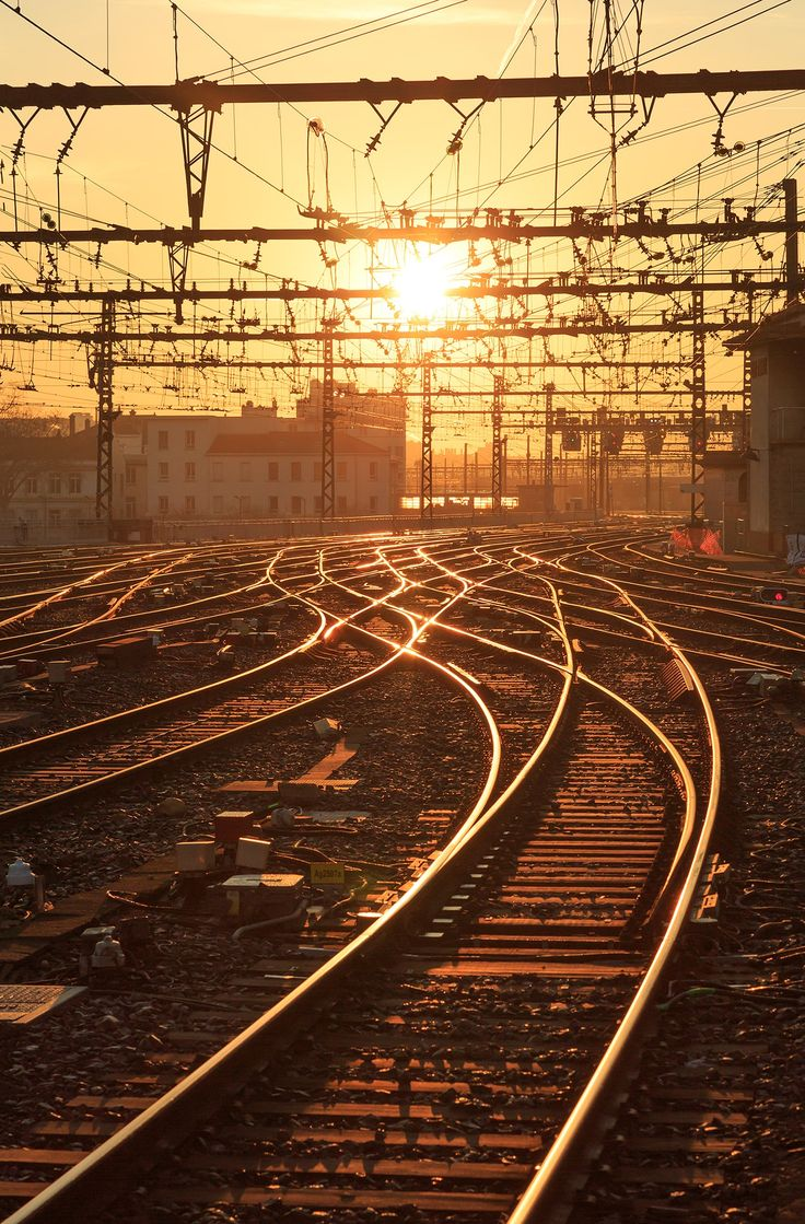 "Golden Gare - Sunrise over the empty railroad tracks at Gare de Lyon-Perrache in Lyon, France. The station, in the 2e arrondisement, was opened in 1855. It was the main station in Lyon until Gare Part-Dieu took over this role in the 1970's.  If you like my work, you can follow me at <a href=""https://www.instagram.com/sandervdw/"">INSTAGRAM </a> for a near daily feed."