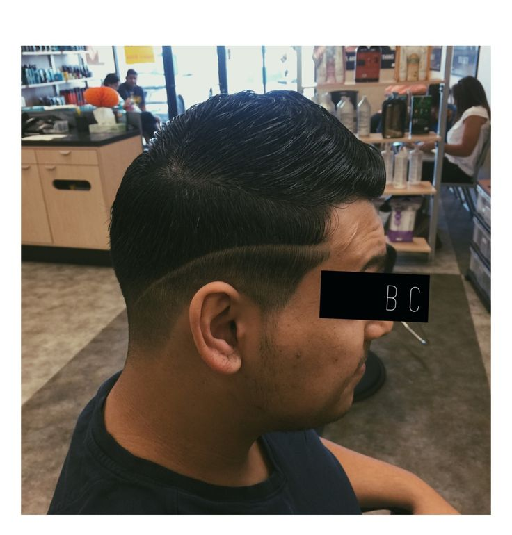 Haircut of the day. Mid fade comb over/pompadour hard part.  Instagram @zekebarks