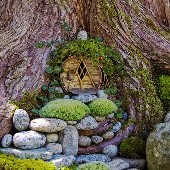 We all need a little magic in our lives. But what a lot of us don't need is a tiny garden full of fairy statues with vacant, thousand yard stares. So we've rounded up the twelve most gorgeous, whimsical fairy garden designs, with not a single figurine in sight.