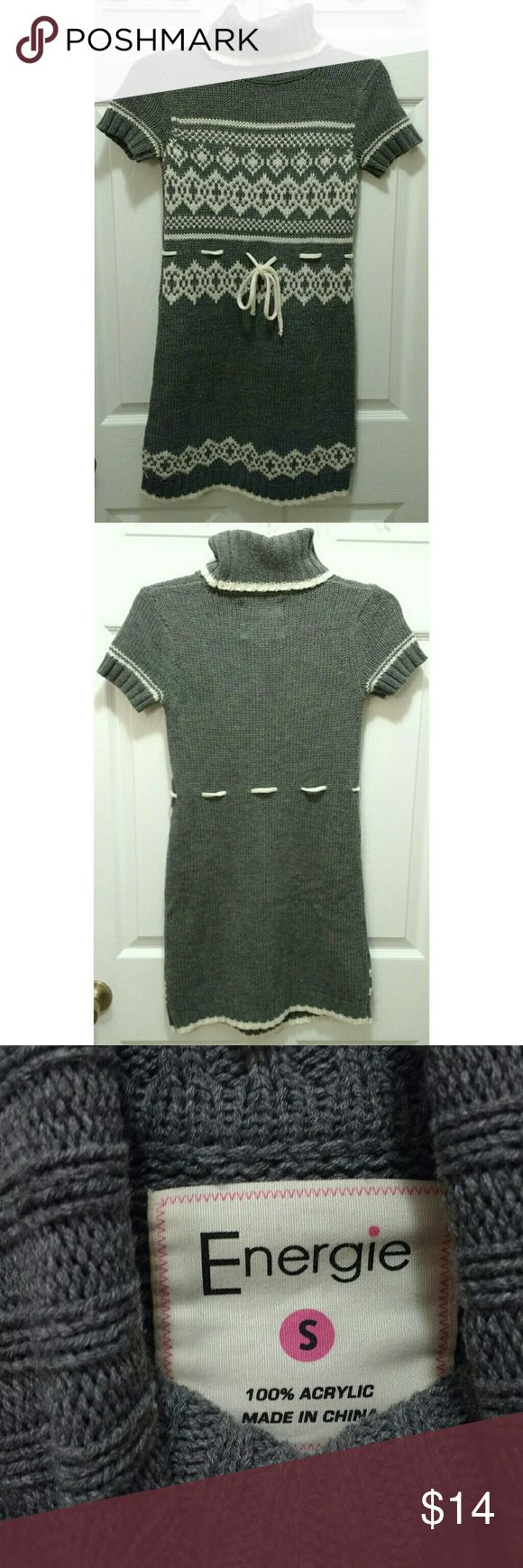 """Energie gray short sleeve sweater dress/tunic Energie gray and white short sleeve turtleneck sweater dress/tunic, size small.  It's 31"""" from shoulder to hem.  I'm 5'7"""", so it's definitely a mini dress for me (it may be better classified as a tunic).  It's 15"""" across the chest, but stretchy. Energie Sweaters Cowl & Turtlenecks"""