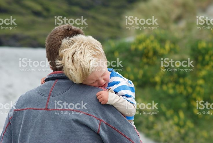 Tired Toddlers cuddles his Father royalty-free stock photo