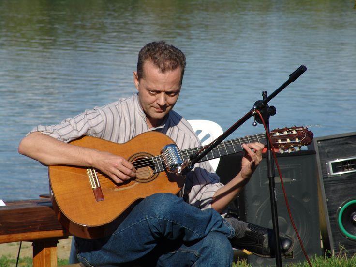 Bak Zoltán gitárművész (1963-2012) A fénykép akkor készült, amikor életemben egyetlenegyszer hallottam őt gitározni, és egy méterre ülhettem tőle. Zoltan Bak was born in Györ, Hungary in 1963 and passed away in 2012. The styles of Bak's own compositions confirm the talent of the guitarist. In addition, Bak applies a new guitar technique in his pieces, which expands the framework of sound and tone.