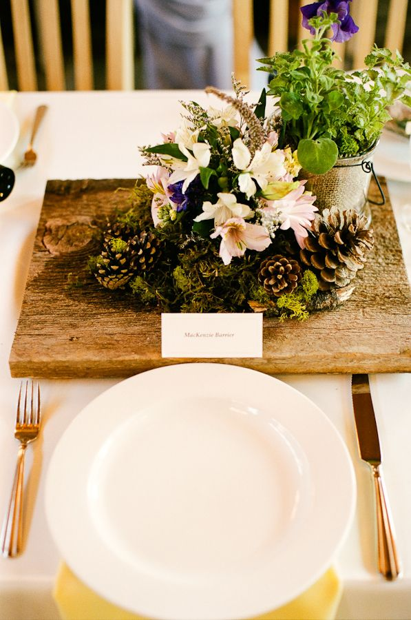 Rustic moss pinecone wood centerpiece