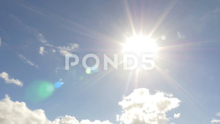 Beautiful Sun and Blue Sky Clouds Lens Flare - Stock Footage | by RyanJonesFilms