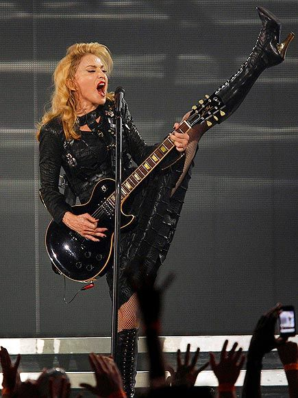 Madonna gets the party started with a guitar solo as she kicks off the North American stretch of her MDNA tour in Philadelphia, Penn., on Tuesday at the Wells Fargo Center.