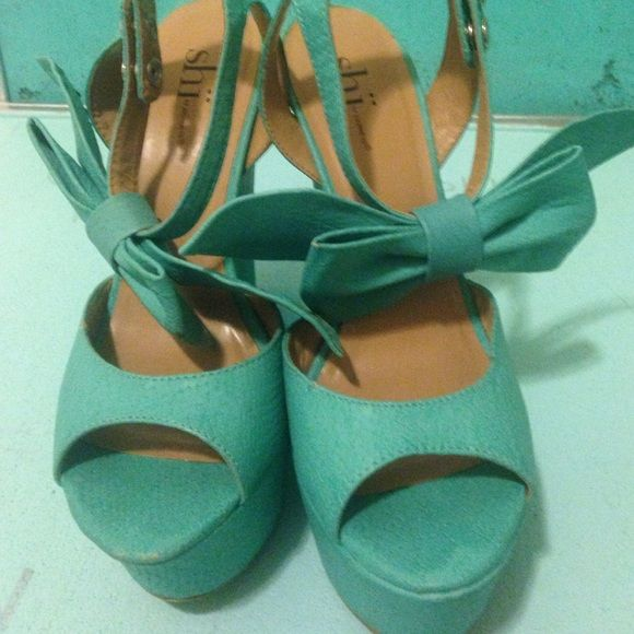 Turquoise wedges with oversized bow Probably the cutest heels ever, oversized bow, great pop of color with any outfit. Always complimented! Shoes Wedges