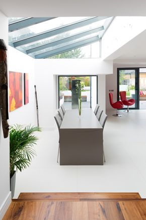Granit Architects Pelham Road, Wimbledon Dining space, outlook onto garden, water feature, lots of light