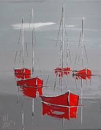 Gorgeous red boats on calm gray water.