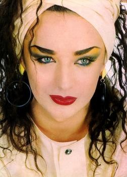 Boy George - legit 80's makeup..totally unfair how great as a girl he looks :p #muzikool , visit Muzikool.com and select 80s in the decade selector! Get Set Go!
