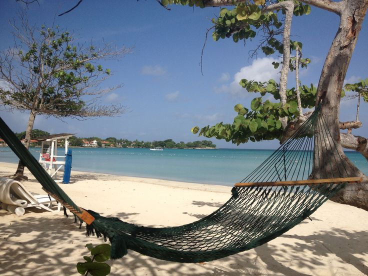 Relax in a hammock beachside on vacation in #jamaica #couplesnegril