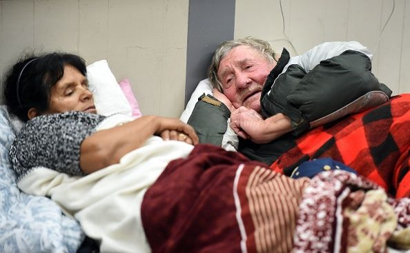 Evacuees Steve Allen and Alicia Castro lay on a cot at the Placer County Fairgrounds evacuation center in Roseville California on February 13 2017... #13Feb2017 in #OrovilleCaliforniaDamEvacuation