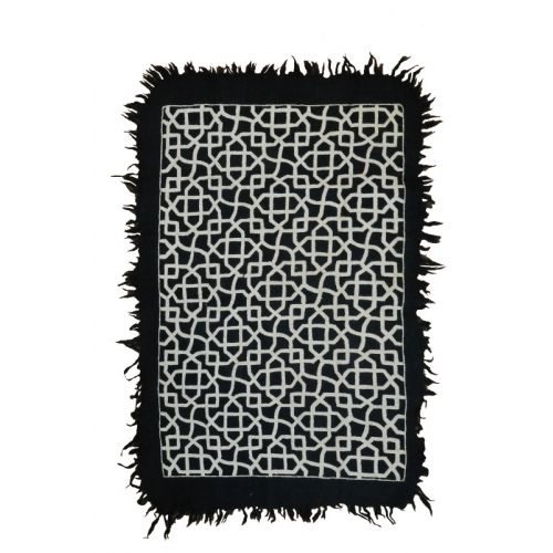 MUGHAL CARPET by TIKAU / Hand felted rug and hand embroidered pattern. Felted wool, 3 –5 % cotton, woolen embroidery. Size: 125x175 cm (size without the fringe) Colours: black/natural white