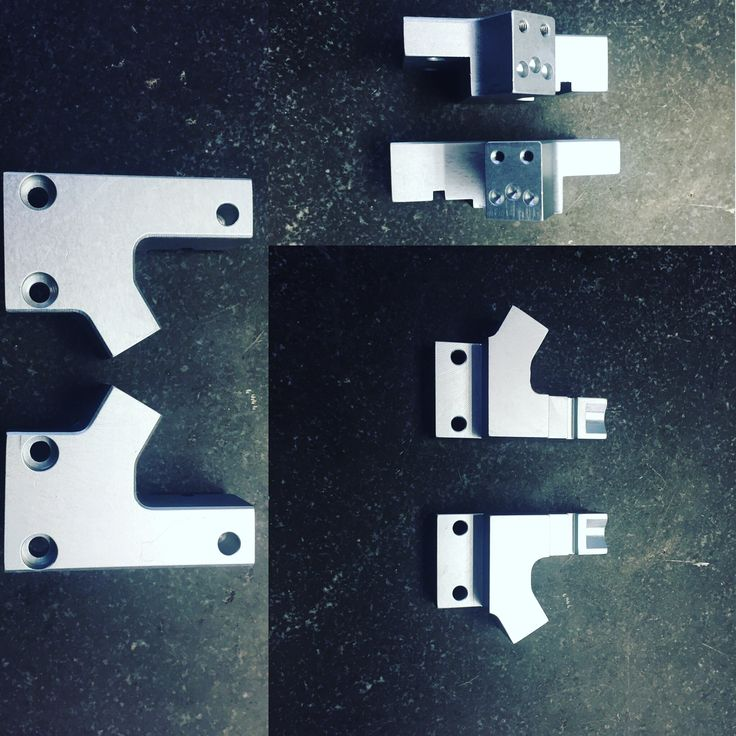 Left and right hand precision machined aluminum fingers for a pick and place robot application. #tooling #robotTooling #Robotics #Robots #RobotParts #RobotPart #Fingers #RobotFingers #MadeInAmerica #MadeInUSA #MadeInMichigan #USManufacturing #Manutec #MichiganMade #AmericanMade #CNCMilling #CNCMilled #PrecisionMachining #PrecisionMade