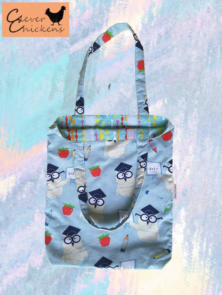 Owls library bag featuring padded handles and velcro closure.