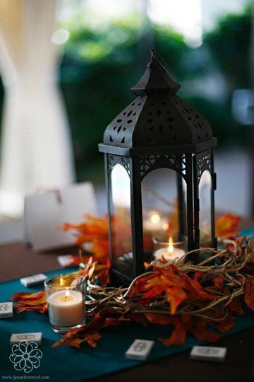 Blue Brown Orange Centerpieces Fall -- can't have real candles, but these lanterns are pretty cool