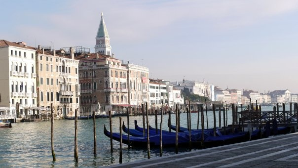 Gondolas, by Salute stop along the Grand Canal, Venice, Italy