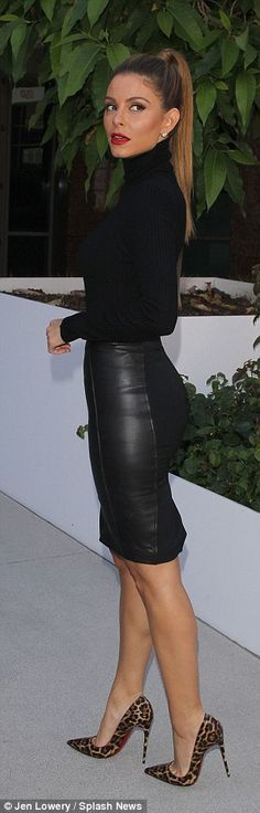 Fall outfit:The former WWE Diva donned a simple black knit turtleneck by Naked Wardrobe, while she opted for a chic leather pencil skirt from Reiss Fashion that ended just above the knee, and served to showcase her impressively toned legs