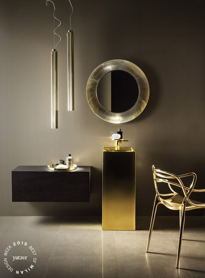 KARTELL by LAUFEN collection by Ludovica+Roberto Palomba.Freestanding washbasin, 37,5x43,5xh90 cm, with special hidden outlet, made of Fine Fire Clay in customized gold glazing. Washbasin mixer disc, fixed spout 11 cm, without pop-up waste. Polycarbonate ALL SAINTS mirror, diam. 78 cm in gold colour. Wall cabinet with push and pull drawer from the collection BOUTIQUE. Couple of polycarbonate pendant RIFLY lamps diam 8 cm, h 90 cm in gold colour with plisse' effect.