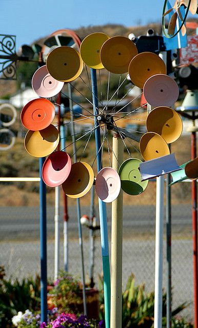 """""""Old bicycle wheel turned into a whirlagig for the garden....great alternative to a scare crow!"""" said one pinner.          ~ I'm inspired to have the kids paint old pot lids, and attach to the wheel = collaborative art project."""